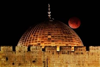 The Moon glows orange as it is seen above the Dome of the Rock ...